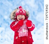 baby playing with snow in... | Shutterstock . vector #719719342