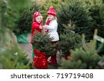 family selecting christmas tree.... | Shutterstock . vector #719719408