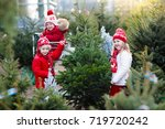 family selecting christmas tree.... | Shutterstock . vector #719720242