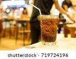 glass of fresh cola in...   Shutterstock . vector #719724196