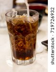 ice cola in a grass | Shutterstock . vector #719726932
