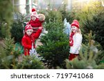 family selecting christmas tree.... | Shutterstock . vector #719741068