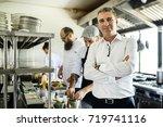 restaurant kitchen chef with... | Shutterstock . vector #719741116