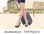 woman with hand luggage in... | Shutterstock . vector #719742172