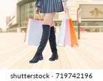 young woman with shopping bags... | Shutterstock . vector #719742196