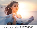 young girl on holiday | Shutterstock . vector #719788348
