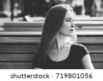 young girl in shorts  sits on a ... | Shutterstock . vector #719801056
