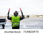 ground crew signaling to... | Shutterstock . vector #719803975