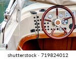 control panel and helm on motor ... | Shutterstock . vector #719824012