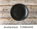 empty black plate on an old...   Shutterstock . vector #719844445