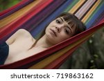 woman relaxing in a hammock | Shutterstock . vector #719863162