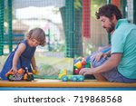 father play with his toddler... | Shutterstock . vector #719868568