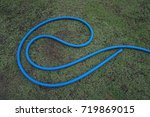 watering hoses on a green lawn. | Shutterstock . vector #719869015