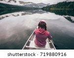 girl on a canoe is enjoying... | Shutterstock . vector #719880916