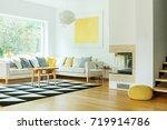 yellow pouf near fireplace in... | Shutterstock . vector #719914786