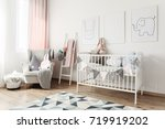white baby's bed with banner... | Shutterstock . vector #719919202
