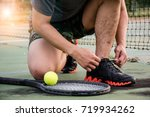 Small photo of Tennis ball and player.