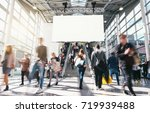 crowd of anonymous blurred... | Shutterstock . vector #719939488