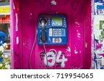 Old Magenta Phone Booth Spraye...