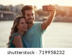 young boyfriend and his... | Shutterstock . vector #719958232