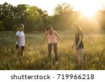 smiling girls doing yoga... | Shutterstock . vector #719966218