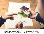 housing developer agent holding ... | Shutterstock . vector #719967742
