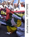 Small photo of DHAKA, BANGLADESH - SEPTEMBER 22, 2017: Bangladeshi Islamic groups burn a national flag of Myanmar and a mock coffin of Myanmar's State Counsellor Aung San Suu Kyi after Friday prayers in Dhaka.