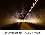 cyclists commuting in a tunnel... | Shutterstock . vector #719977405