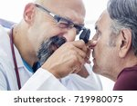 elderly man examined by an... | Shutterstock . vector #719980075