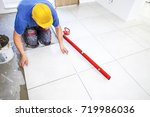 laying tiles at home.... | Shutterstock . vector #719986036