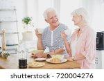 smiling marriage of elders eat... | Shutterstock . vector #720004276