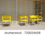 bright yellow chairs lined up... | Shutterstock . vector #720024658