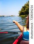 the girl floats on the kayak... | Shutterstock . vector #720034216