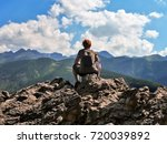 a girl rests on top of a... | Shutterstock . vector #720039892