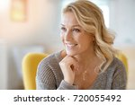 portrait of beautiful 40 year... | Shutterstock . vector #720055492