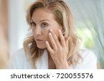 portrait of attractive blond... | Shutterstock . vector #720055576