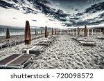 closed dekchairs and umbrellas...   Shutterstock . vector #720098572
