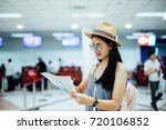 happy women tourist on map to ... | Shutterstock . vector #720106852
