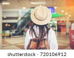 happy woman tourist atin the... | Shutterstock . vector #720106912