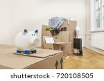 stacked moving cartons are in... | Shutterstock . vector #720108505