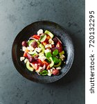 greek salad with cucumeber ... | Shutterstock . vector #720132295
