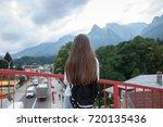 young girl traveler looking at... | Shutterstock . vector #720135436