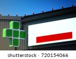 a green pharmacy sign on the... | Shutterstock . vector #720154066