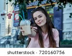 smiling woman drinking...   Shutterstock . vector #720160756