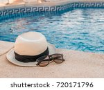 hat and sunglasses at the pool. ... | Shutterstock . vector #720171796