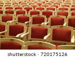 rows of old red chairs in... | Shutterstock . vector #720175126