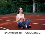 beautiful fitness athlete woman ...   Shutterstock . vector #720203512