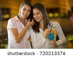 two beautiful business women...   Shutterstock . vector #720213376