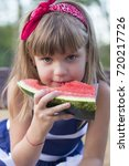close up cute little girl with...   Shutterstock . vector #720217726