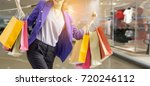 woman holding shopping bag in... | Shutterstock . vector #720246112